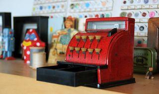 Toy register on shelf