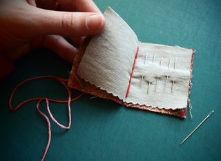 Needle book_hand