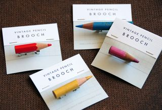 Pencil brooches