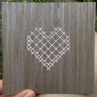 White cross stitch heart