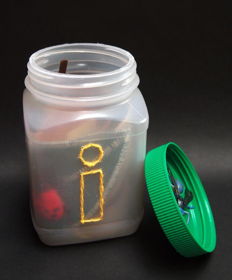 LetterI_Michelle_on black_open jar